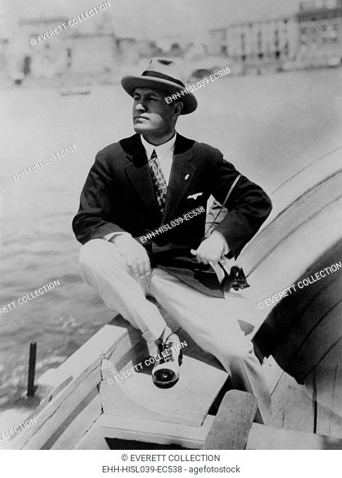 Benito Mussolini seated on boat, facing left, wearing summer suit. Ca.1915-1925. - (BSLOC-2015-1-40)