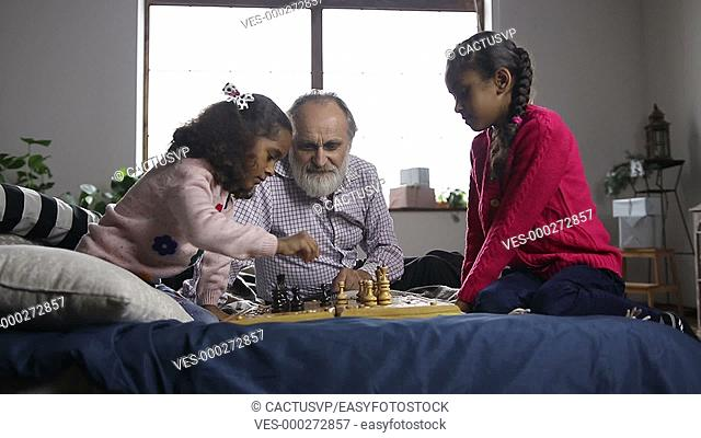 Little girl captured a pawn and celebrates at home