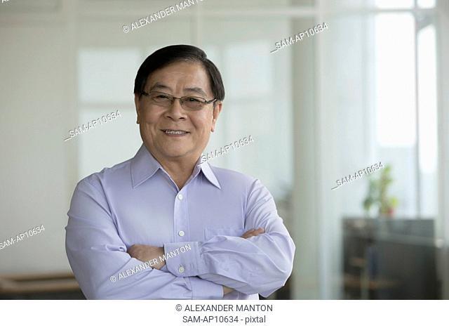 Singapore, Portrait of senior businessman in office