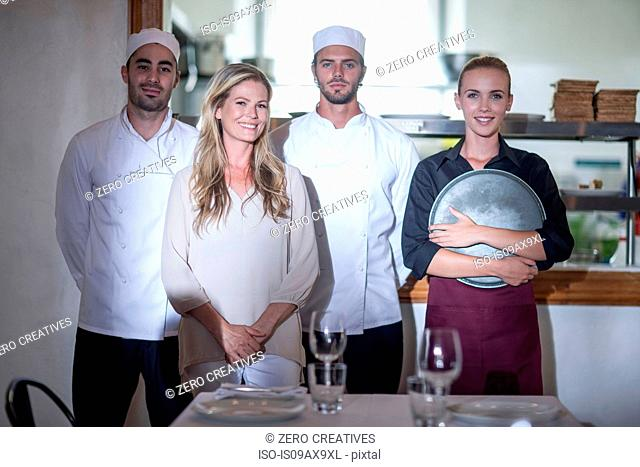 Chefs and waitresses in restaurant