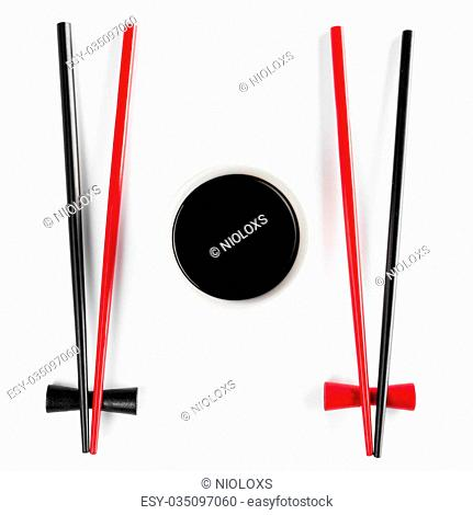 Chopsticks and bowl with soy sauce