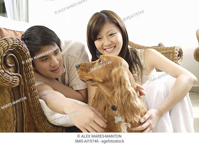 Couple with Cocker Spaniel dog