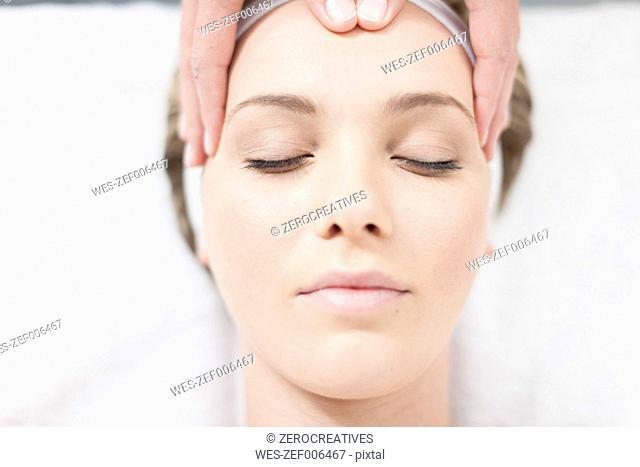 Cosmetician giving facial massage