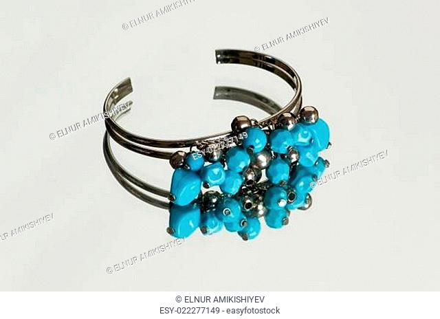 Bracelet with blue stones on reflective background