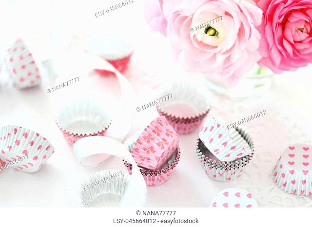 Alumi cups with pink ranunculus flowers