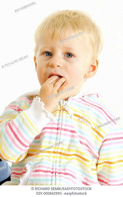 portrait of toddler eating mandarin