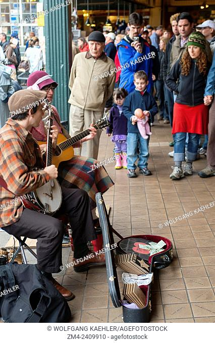 Two street performers playing music at the Pike Place Market in Seattle, Washington State, USA