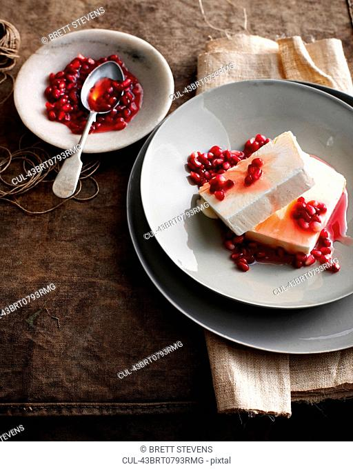 Plate of ice cream with pomegranate