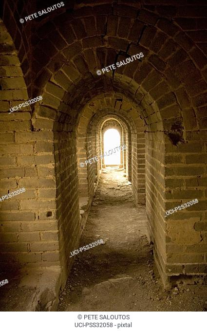 Corridor with stone archways in the Great Wall of China