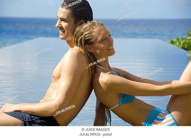 Couple relaxing near pool