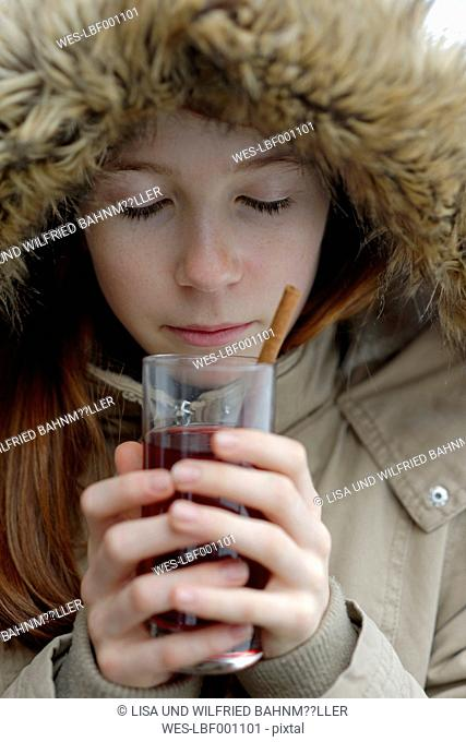 Girl holding glass of hot punch