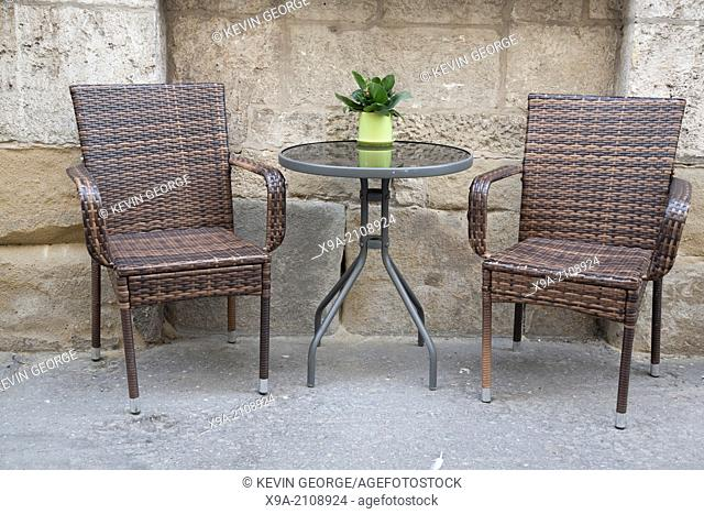 Cafe Table and Chair in Urban Setting