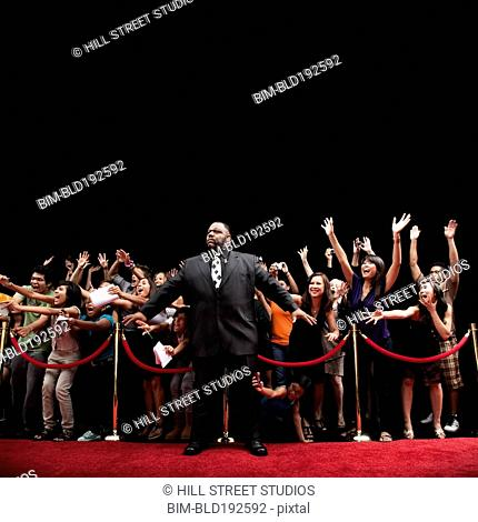 African bounder and screaming fans on the red carpet