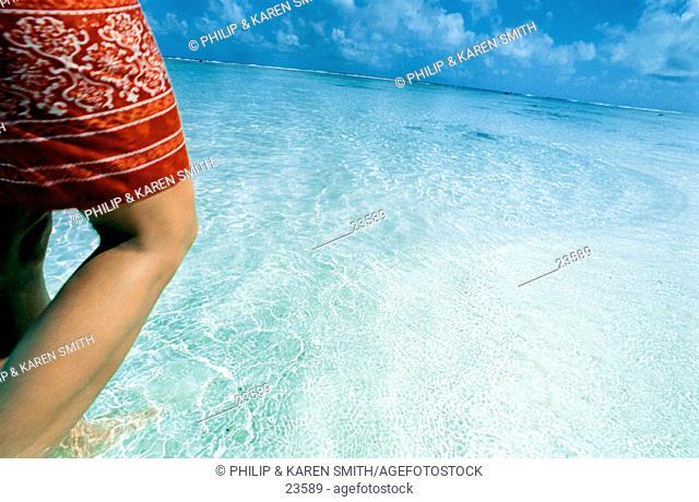Woman's legs in ocean. Cook Islands