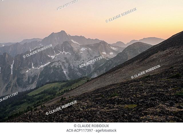 Panoramic view of the Cascade mountains at sunset from the summit of Frosty Mountain in Manning provincial park, British Columbia, Canada