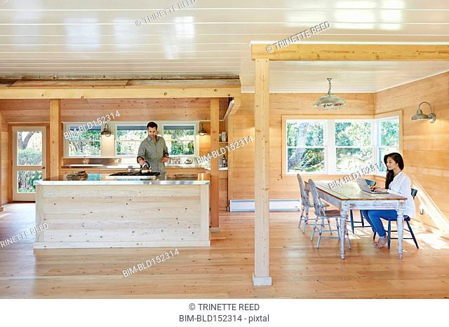Couple relaxing in open kitchen and dining area
