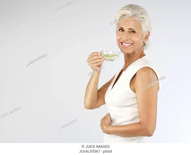 Happy senior woman with tea, portrait