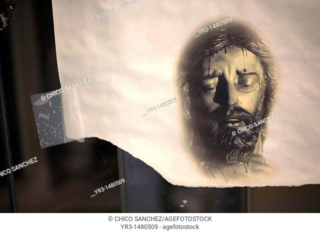 A drawing of Jesus Christ's face is displayed in a street of Cordoba, Andalusia, Spain, April 17, 2011