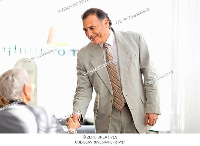 Businessman shaking colleague?s hand