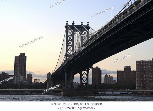 Manhattan Bridge landscape at sunset over East River, New York, USA