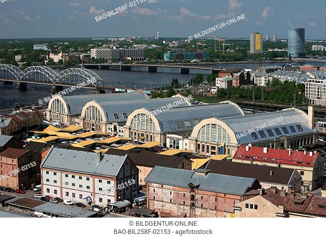 The part of town small Moscow on the river Daugava with the market and the covered markets of Riga from view of the view patio of the socialist high rise...