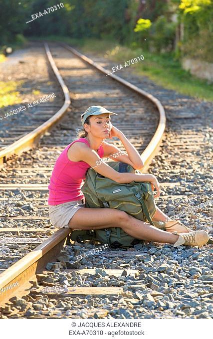 Woman sitting on track