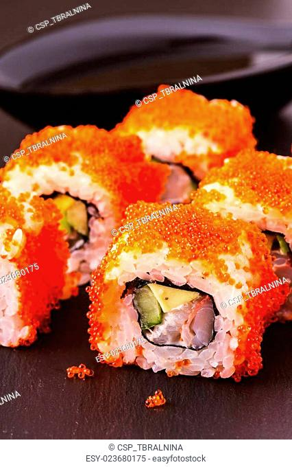 Sushi roll with crab, avocado, cucumber and tobiko