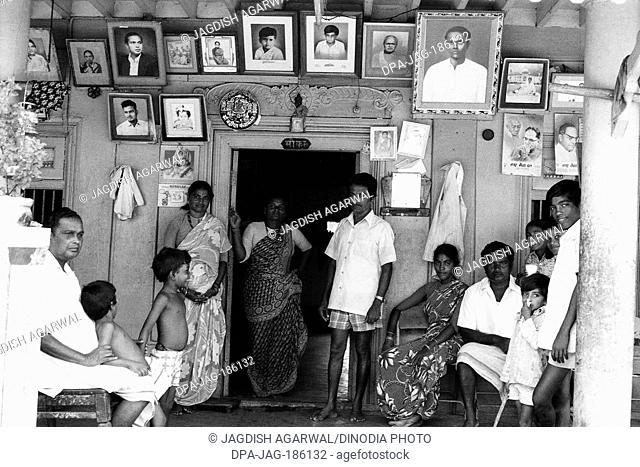 Family and ancestor photo frames Versova Mumbai Maharashtra India Asia 1977