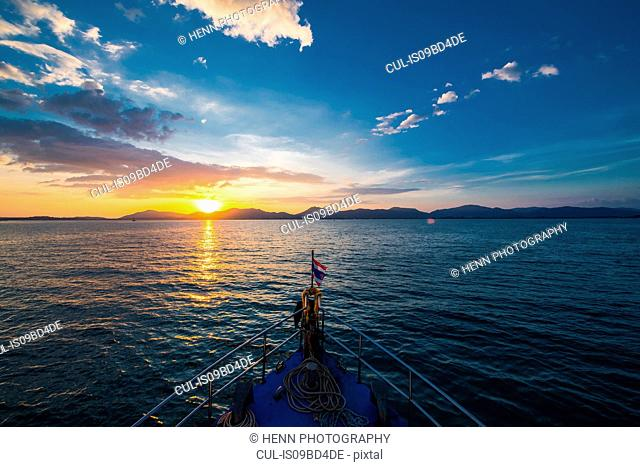 Bow of a dive boat heading to the sunset, Phuket, Thailand