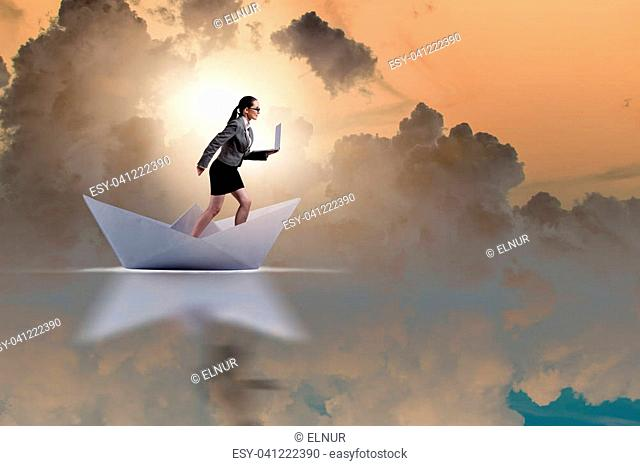 Businesswoman riding paper boat ship in business concept