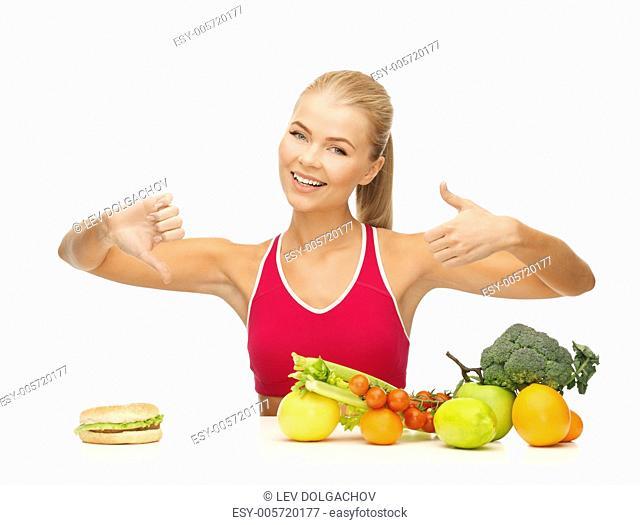 woman with fruits and hamburger showing good and bad signs