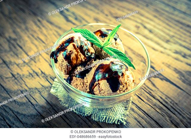 Chocolate ice cream with dessert topping