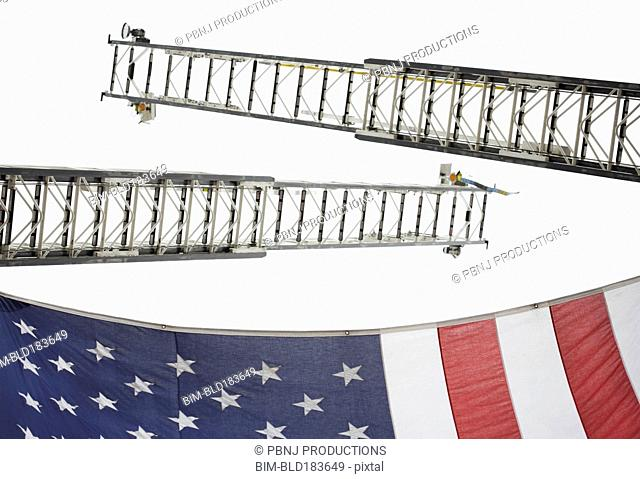 Low angle view of crane ladders and American flag
