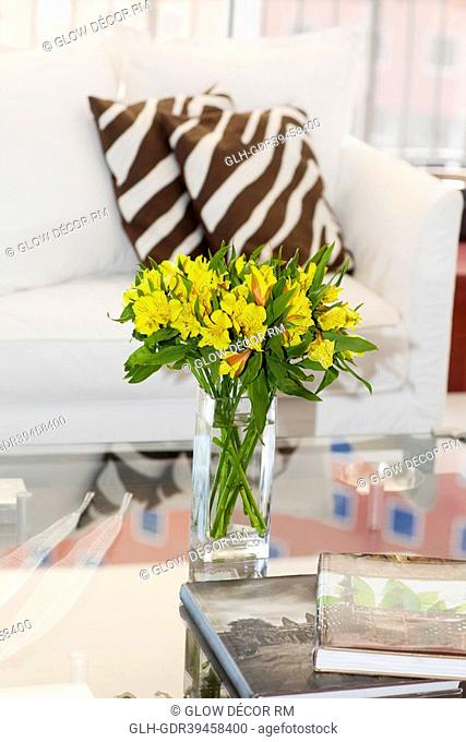Vase of flowers on a table in a living room