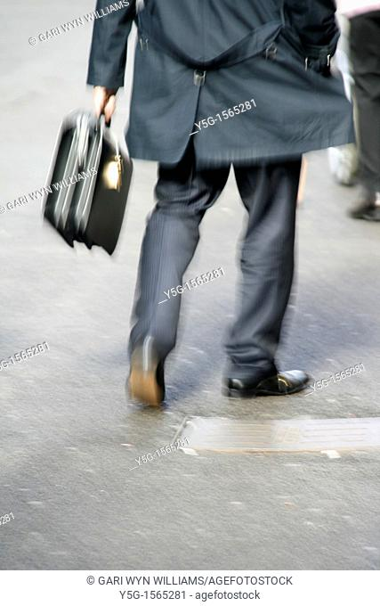 one male commuter carrying briefcase in town in rome italy