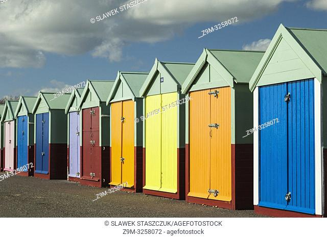 Winter afternoon at the colourful beach huts on Brighton and Hove seafront, East Sussex, England