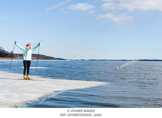 Woman standing on ice floe