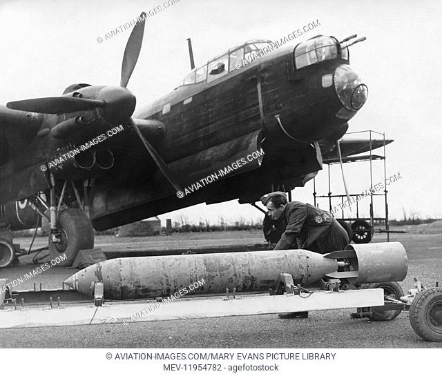 A 2000 Pound Bomb Being Loaded Onto an RAF Avro 679 Manchester Bomber