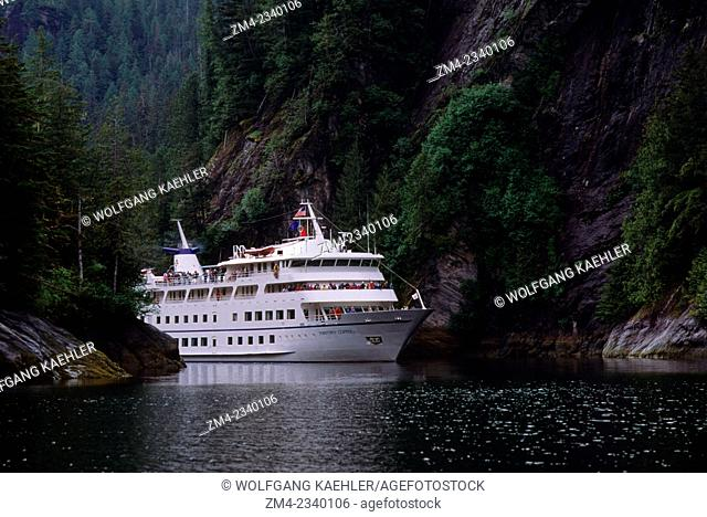 Cruise ship Americana (former Yorktown Clipper) passing through narrows in Rudyerd Bay in Tracy Arm near Ketchikan, Alaska, United States of America