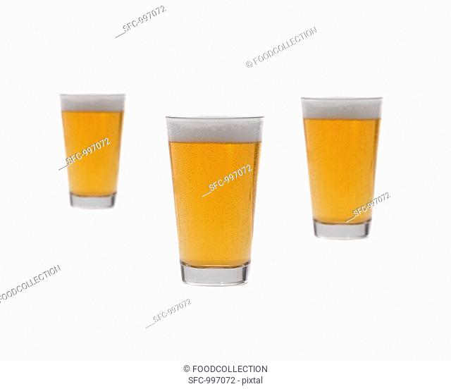 Three glasses of lager