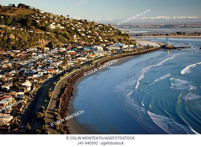 Sumner beach suburb near Christchurch, snow covered Southern Alps behind, South Island, New Zealand