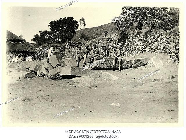 Archaeologist Ugo Monneret de Villard with some Italian soldiers sitting on broken stele, Axum, Ethiopia, photograph by Ugo Monneret de Villard, 1937