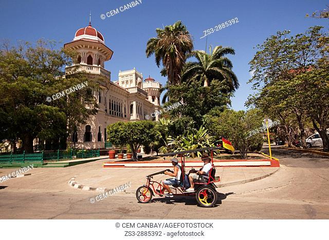Bici taxi in front of the Palacio De Valle -Valle's Palace In Punta Gorda district, Cienfuegos, Cuba, West Indies, Central America