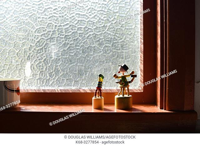 Little sculptures on a window sill in an apartment interior in Port Chalmers, New Zealand