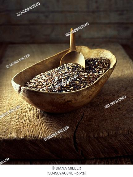 Organic bakery ingredients, wooden bowl with mix of poppy sunflower and flax seeds