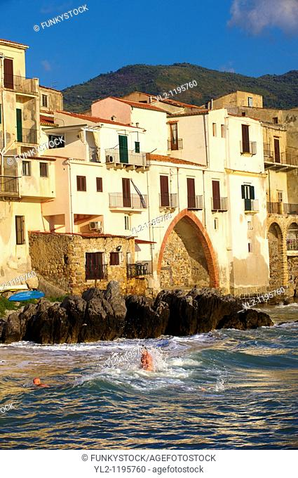 Medieval houses and seafront of old Cefalu Sicily