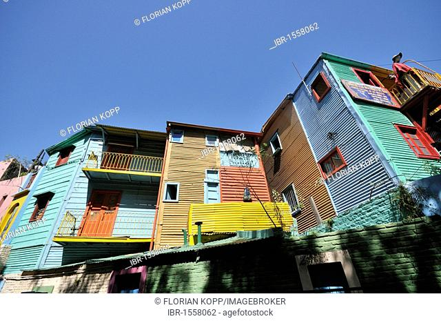 Colourfully painted houses made of corrugated sheet at El Caminito Street, tourist attraction in the former harbour district of La Boca, Buenos Aires, Argentina