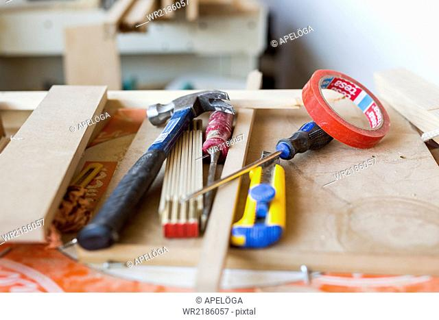 Hand tools on wooden plank in workshop
