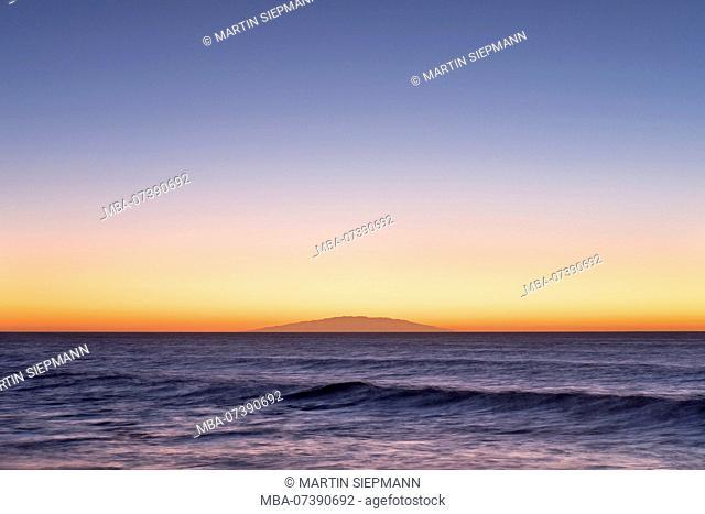 Sea wave at dusk, behind the island El Hierro, Valle Gran Rey, La Gomera, Canary Islands, Canaries, Spain
