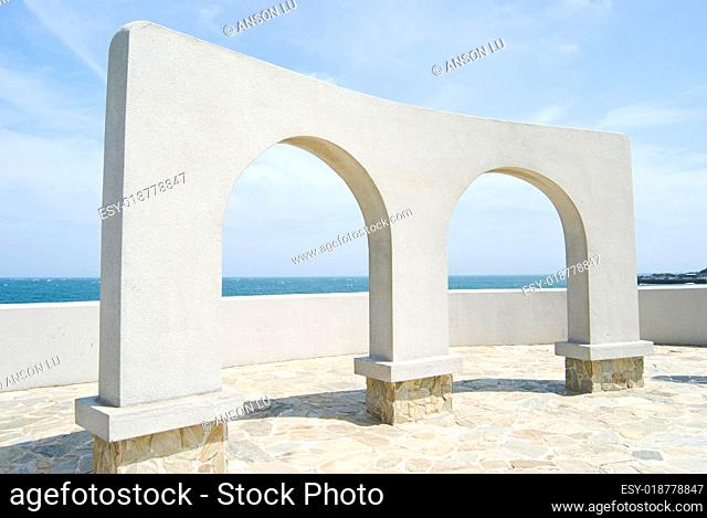 beautiful architecture, arch door decoration near ocean